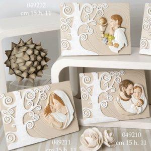 Bomboniere sacre realizzate in resina con immagini religiose e Albero della vita. Adatte per battesimo e comunione sia per bimbo sia per bimba.