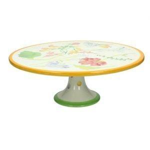 L'alzata Blooming Garden Tognana è fatta di una ceramica di alta qualità. Serve non solo per presentare una torta, ma anche per un buffet, cene con amici, antipasti e altre portate. Lavabile in lavastoviglie.