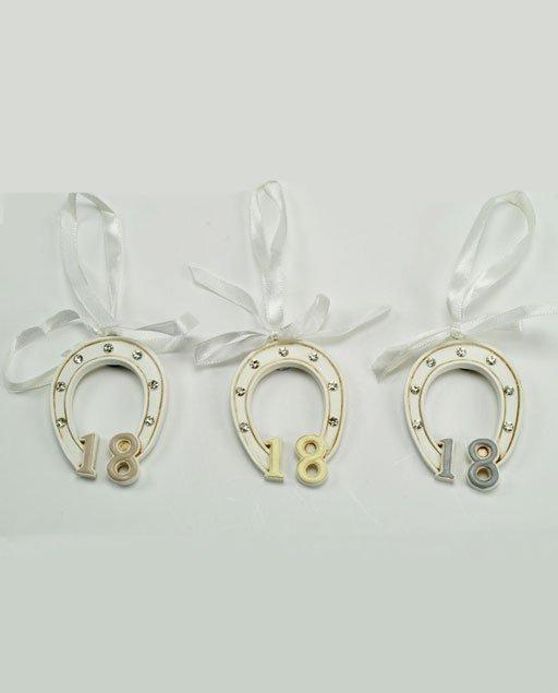 Bomboniera compleanno calamita ferro di cavallo 18 anni. È un simbolo con importante significato di buon augurio per una vita ricca, piena ed intensa.