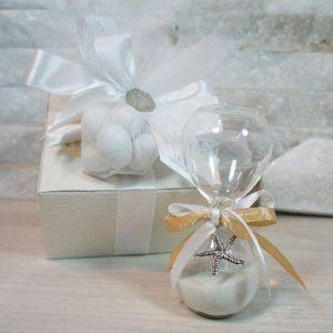 Bomboniera Clessidra stella marina realizzata in vetro soffiato. Ideale per essere utilizzata per eventi: Comunione, Cresima.