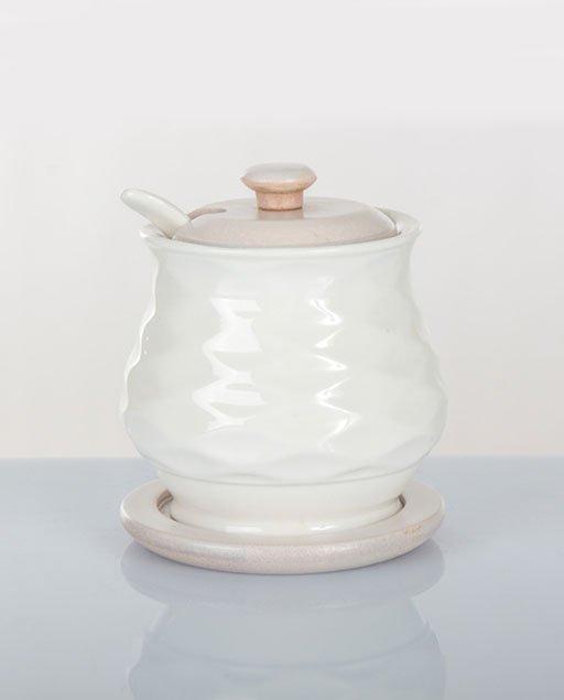 Zuccheriera matrimoniocompleta di un cucchiaino in porcellana