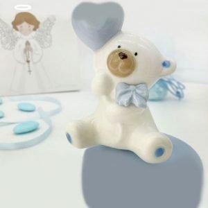 Bomboniera orsetto carillon ruota l'orsetto in senso orario produrrà una dolce ninna nanna.