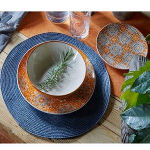 Servizio di piatti Curcuma Tognana realizzati in porcellana. Tavola contemporanea con colori caldi, per uno stile esotico