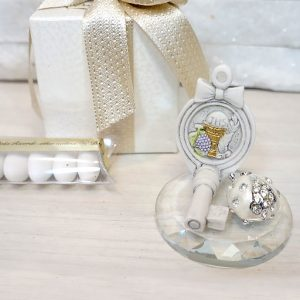 Bomboniera Comunione in cristallo raffigurante una chiave in resina, coccinella portafortuna in strass