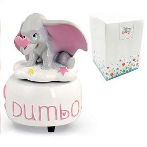 """Bomboniera Dumbo carillon realizzato in resina lucida con base bianca, decorata da scritta """"Dumbo"""", nuvolette, stelline e cuoricini rosa con statuettaelefantino Dumbo"""