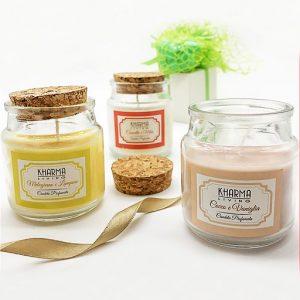 Candela profumata assortita in tre fragranze: Melograno e Lampone, Cannella e Mela, Cocco e Vaniglia.